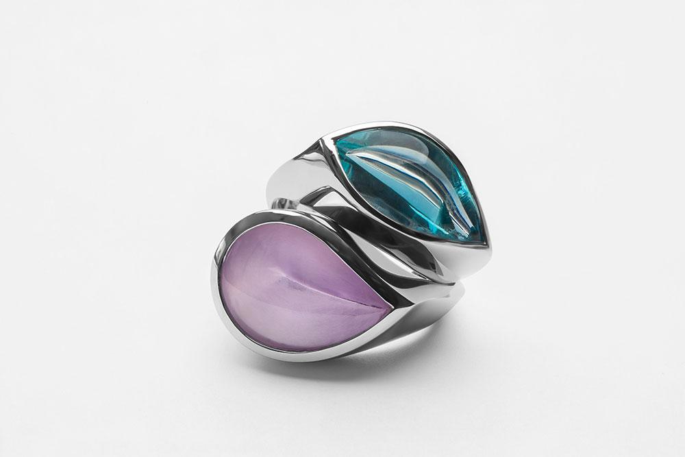 Esterstyl - Prsten z bílého zlata se světle modrým akvamarínem a Prsten z bílého zlata s fialkovým ametystem ve tvaru slzy