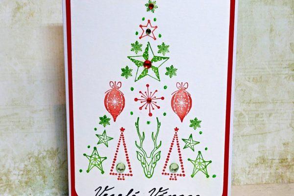 Pomocí razítek si vyrobíte krásné vánoční přáníčko. Foto: www.aladine.cz