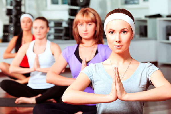 Můžeme si vybrat trenéra nejen pro klasický trénink v posilovně, ale i pro běh, jógu, tanec, pilates či pro bojové sporty. Foto: www.imagio.cz